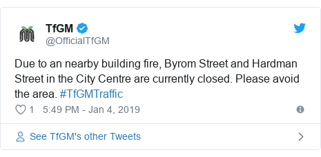 Twitter post by @OfficialTfGM: Due to an nearby building fire, Byrom Street and Hardman Street in the City Centre are currently closed. Please avoid the area. #TfGMTraffic