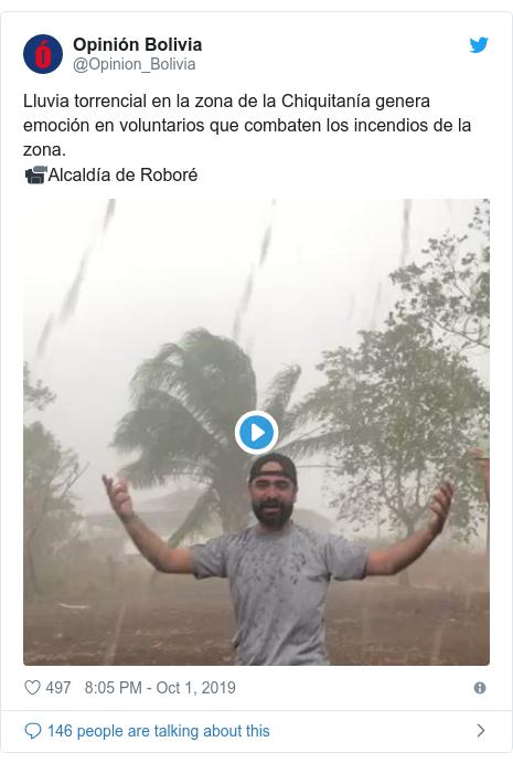 Twitter post by @Opinion_Bolivia: Lluvia torrencial en la zona de la Chiquitanía genera emoción en voluntarios que combaten los incendios de la zona.📹Alcaldía de Roboré