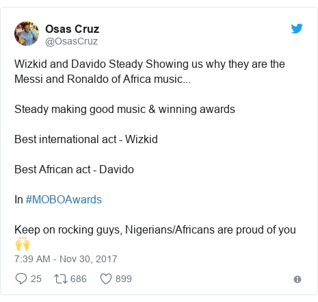 Twitter post by @OsasCruz: Wizkid and Davido Steady Showing us why they are the Messi and Ronaldo of Africa music... Steady making good music & winning awards Best international act - Wizkid Best African act - Davido In #MOBOAwards Keep on rocking guys, Nigerians/Africans are proud of you 🙌