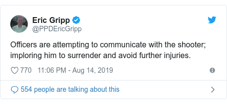 Twitter post by @PPDEricGripp: Officers are attempting to communicate with the shooter; imploring him to surrender and avoid further injuries.
