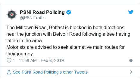 Twitter post by @PSNITraffic: The Milltown Road, Belfast is blocked in both directions near the junction with Belvoir Road following a tree having fallen in the area. Motorists are advised to seek alternative main routes for their journey.
