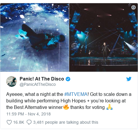 Twitter post by @PanicAtTheDisco: Ayeeee, what a night at the #MTVEMA! Got to scale down a building while performing High Hopes + you're looking at the Best Alternative winner🔥 thanks for voting 🙏