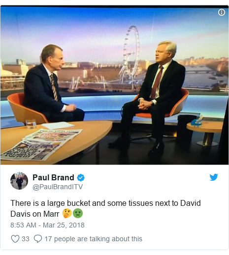 Twitter post by @PaulBrandITV: There is a large bucket and some tissues next to David Davis on Marr 🤔🤢