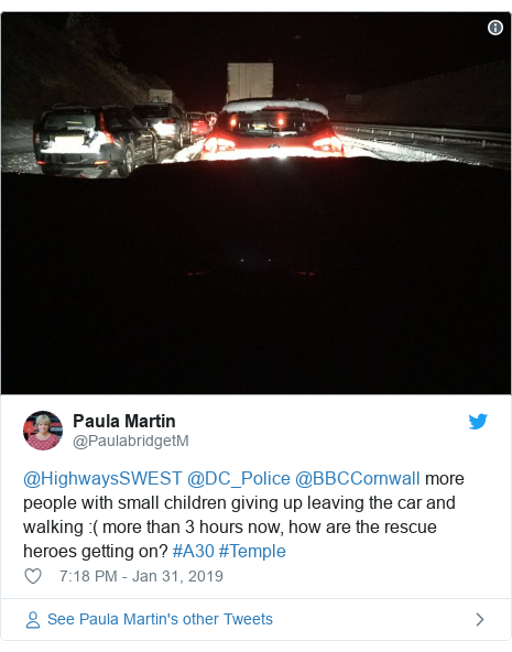 Twitter post by @PaulabridgetM: @HighwaysSWEST @DC_Police @BBCCornwall more people with small children giving up leaving the car and walking  ( more than 3 hours now, how are the rescue heroes getting on? #A30 #Temple