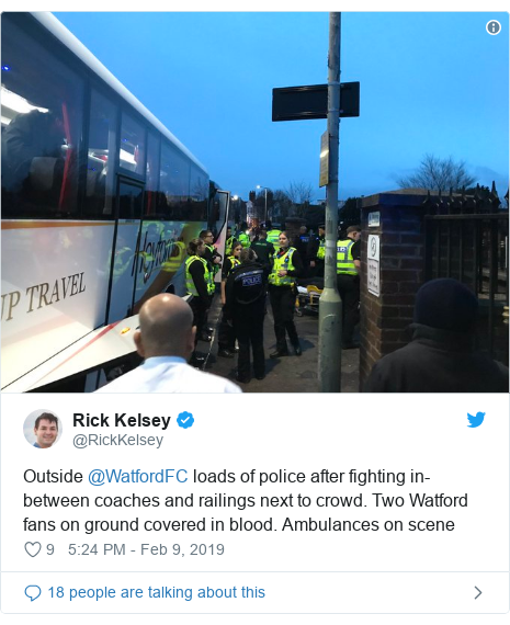 Twitter post by @RickKelsey: Outside @WatfordFC loads of police after fighting in-between coaches and railings next to crowd. Two Watford fans on ground covered in blood. Ambulances on scene