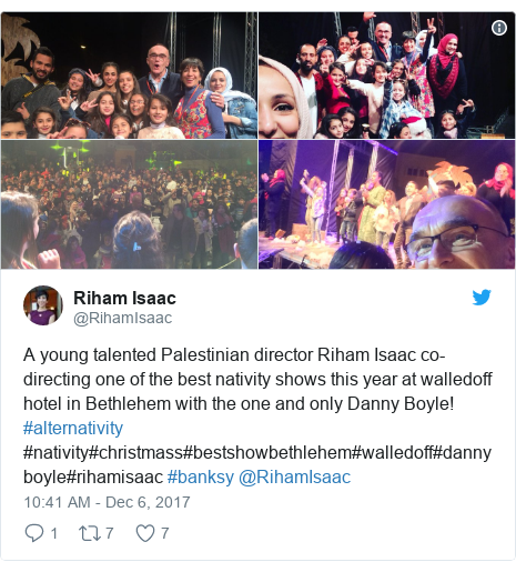 Twitter post by @RihamIsaac: A young talented Palestinian director Riham Isaac co-directing one of the best nativity shows this year at walledoff hotel in Bethlehem with the one and only Danny Boyle! #alternativity #nativity#christmass#bestshowbethlehem#walledoff#dannyboyle#rihamisaac #banksy  @RihamIsaac