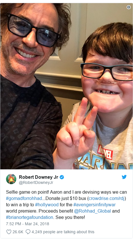Twitter post by @RobertDowneyJr: Selfie game on point! Aaron and I are devising ways we can #gomadforrohhad...Donate just $10 bux () to win a trip to #hollywood for the #avengersinfinitywar world premiere. Proceeds benefit @Rohhad_Global and #brianortegafoundation. See you there!