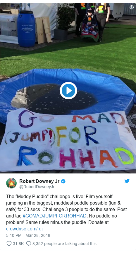 """Twitter post by @RobertDowneyJr: The """"Muddy Puddle"""" challenge is live! Film yourself jumping in the biggest, muddiest puddle possible (fun & safe) for 33 secs. Challenge 3 people to do the same. Post and tag #GOMADJUMPFORROHHAD. No puddle no problem! Same rules minus the puddle. Donate at"""