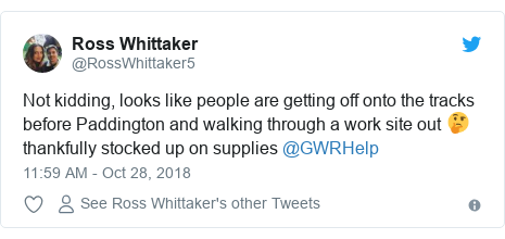 Twitter post by @RossWhittaker5: Not kidding, looks like people are getting off onto the tracks before Paddington and walking through a work site out 🤔 thankfully stocked up on supplies @GWRHelp