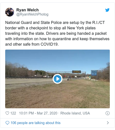 Twitter post by @RyanWelchPhotog: National Guard and State Police are setup by the R.I./CT border with a checkpoint to stop all New York plates traveling into the state. Drivers are being handed a packet with information on how to quarantine and keep themselves and other safe from COVID19.