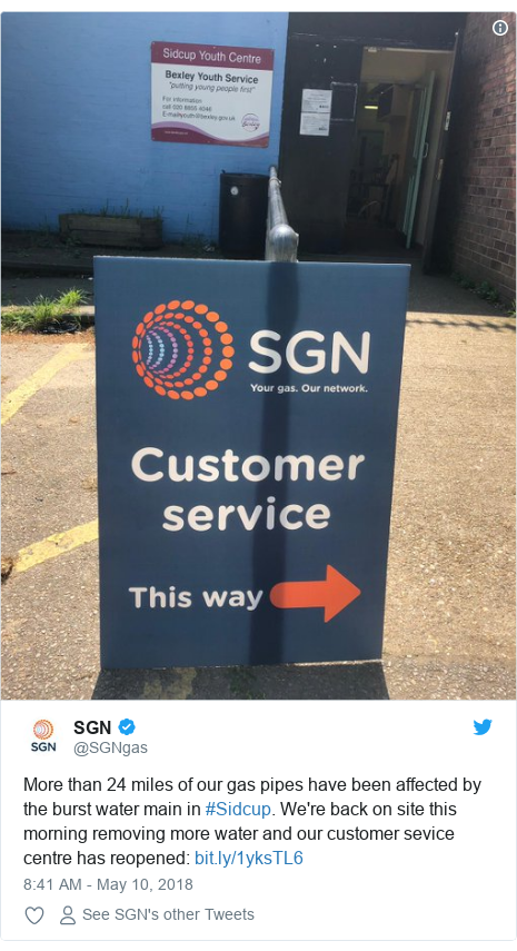 Twitter post by @SGNgas: More than 24 miles of our gas pipes have been affected by the burst water main in #Sidcup. We're back on site this morning removing more water and our customer sevice centre has reopened