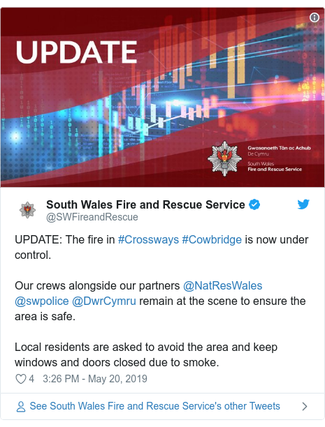 Twitter post by @SWFireandRescue: UPDATE  The fire in #Crossways #Cowbridge is now under control.Our crews alongside our partners @NatResWales @swpolice @DwrCymru remain at the scene to ensure the area is safe.Local residents are asked to avoid the area and keep windows and doors closed due to smoke.