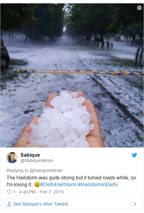 Twitter post by @SabiqueAkhan: The Hailstorm was quite strong but it turned roads white, so I'm loving it. 😁#DelhiHailStorm #HailstorminDelhi