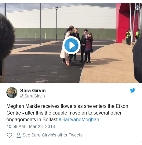 Twitter post by @SaraGirvin: Meghan Markle receives flowers as she enters the Eikon Centre - after this the couple move on to several other engagements in Belfast #HarryandMeghan