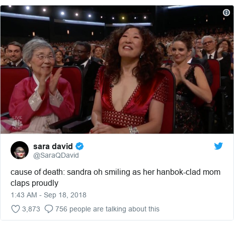 Twitter post by @SaraQDavid: cause of death  sandra oh smiling as her hanbok-clad mom claps proudly