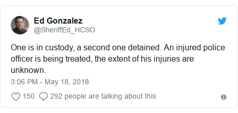 Twitter post by @SheriffEd_HCSO: One is in custody, a second one detained. An injured police officer is being treated, the extent of his injuries are unknown.