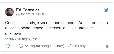 Twitter bởi @SheriffEd_HCSO: One is in custody, a second one detained. An injured police officer is being treated, the extent of his injuries are unknown.