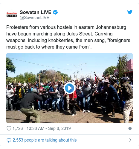 """Twitter post by @SowetanLIVE: Protesters from various hostels in eastern Johannesburg have begun marching along Jules Street. Carrying weapons, including knobkerries, the men sang, """"foreigners must go back to where they came from""""."""