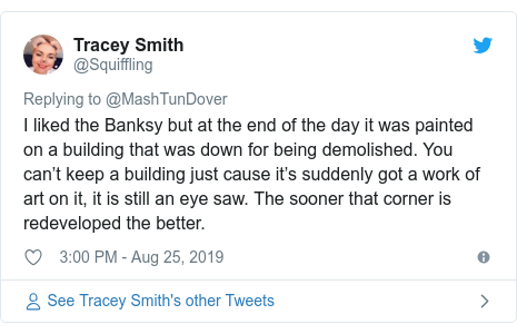 Twitter post by @Squiffling: I liked the Banksy but at the end of the day it was painted on a building that was down for being demolished. You can't keep a building just cause it's suddenly got a work of art on it, it is still an eye saw. The sooner that corner is redeveloped the better.