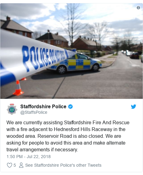 Twitter post by @StaffsPolice: We are currently assisting Staffordshire Fire And Rescue with a fire adjacent to Hednesford Hills Raceway in the wooded area. Reservoir Road is also closed. We are asking for people to avoid this area and make alternate travel arrangements if necessary.