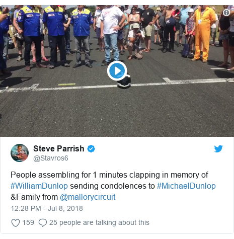 Twitter post by @Stavros6: People assembling for 1 minutes clapping in memory of #WilliamDunlop sending condolences to #MichaelDunlop &Family from @mallorycircuit