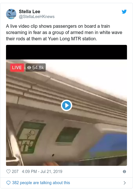 Twitter post by @StellaLeeHKnews: A live video clip shows passengers on board a train screaming in fear as a group of armed men in white wave their rods at them at Yuen Long MTR station.
