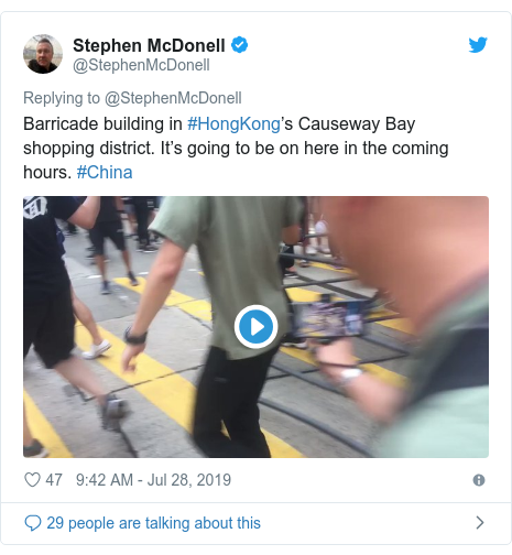 Twitter post by @StephenMcDonell: Barricade building in #HongKong's Causeway Bay shopping district. It's going to be on here in the coming hours. #China