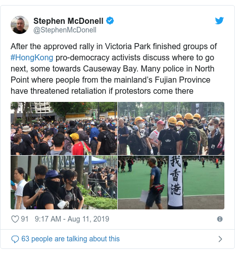 Twitter post by @StephenMcDonell: After the approved rally in Victoria Park finished groups of #HongKong pro-democracy activists discuss where to go next, some towards Causeway Bay. Many police in North Point where people from the mainland's Fujian Province have threatened retaliation if protestors come there