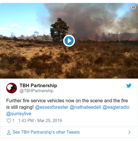 Twitter post by @TBHPartnership: Further fire service vehicles now on the scene and the fire is still raging! @essexforester @nathalieedell @eagleradio @surreylive