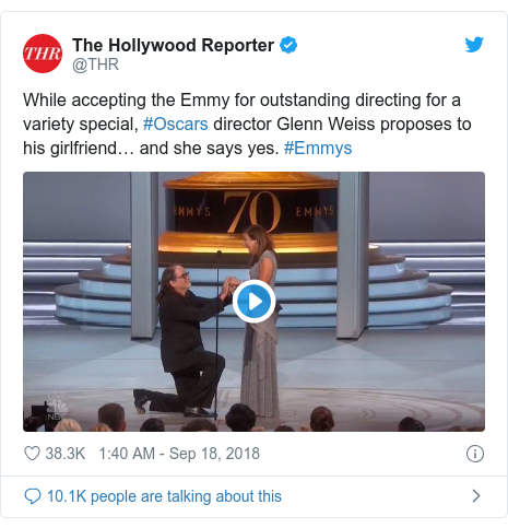 Twitter post by @THR: While accepting the Emmy for outstanding directing for a variety special, #Oscars director Glenn Weiss proposes to his girlfriend… and she says yes. #Emmys