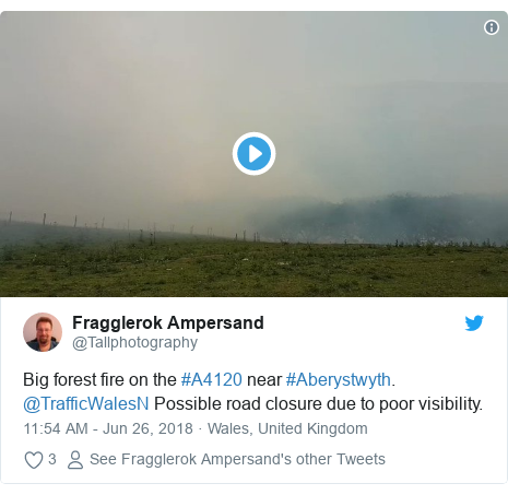 Twitter post by @Tallphotography: Big forest fire on the #A4120 near #Aberystwyth. @TrafficWalesN Possible road closure due to poor visibility.
