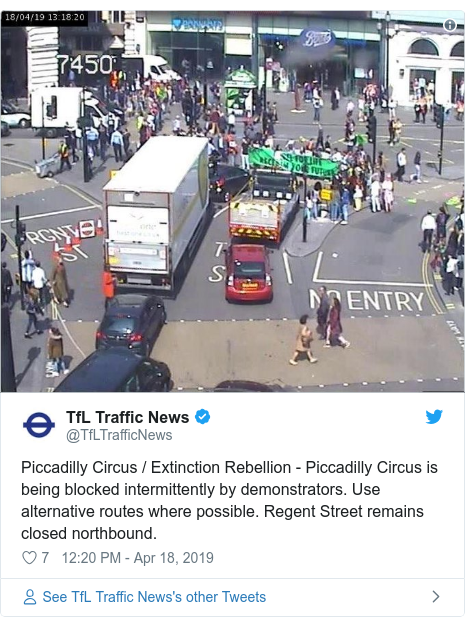 Twitter post by @TfLTrafficNews: Piccadilly Circus / Extinction Rebellion - Piccadilly Circus is being blocked intermittently by demonstrators. Use alternative routes where possible. Regent Street remains closed northbound.
