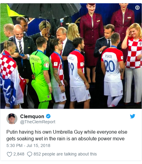 Twitter post by @TheClemReport: Putin having his own Umbrella Guy while everyone else gets soaking wet in the rain is an absolute power move