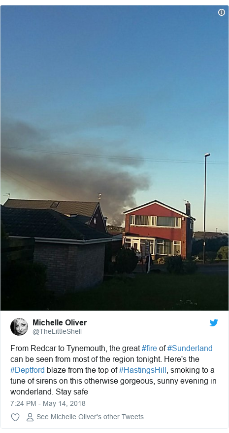 Twitter post by @TheLittleShell: From Redcar to Tynemouth, the great #fire of #Sunderland can be seen from most of the region tonight. Here's the #Deptford blaze from the top of #HastingsHill, smoking to a tune of sirens on this otherwise gorgeous, sunny evening in wonderland. Stay safe