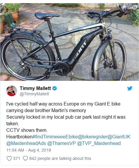 Twitter post by @TimmyMallett: I've cycled half way across Europe on my Giant E bike carrying dear brother Martin's memorySecurely locked in my local pub car park last night it was taken. CCTV shows them.Heartbroken#findTimmeeeeEbike@bikeregister@GiantUK @MaidenheadAds @ThamesVP @TVP_Maidenhead