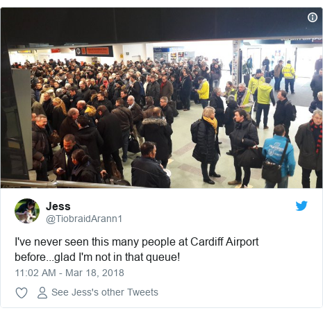 Twitter post by @TiobraidArann1: I've never seen this many people at Cardiff Airport before...glad I'm not in that queue!