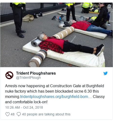 Twitter post by @TridentPlough: Arrests now happening at Construction Gate at Burghfield nuke factory which has been blockaded sicne 6.30 this morning. Classy and comfortable lock-on!