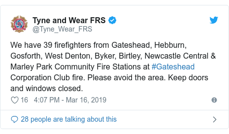 Twitter post by @Tyne_Wear_FRS: We have 39 firefighters from Gateshead, Hebburn, Gosforth, West Denton, Byker, Birtley, Newcastle Central & Marley Park Community Fire Stations at #Gateshead Corporation Club fire. Please avoid the area. Keep doors and windows closed.