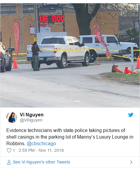Twitter post by @ViNguyen: Evidence technicians with state police taking pictures of shell casings in the parking lot of Manny's Luxury Lounge in Robbins. @cbschicago