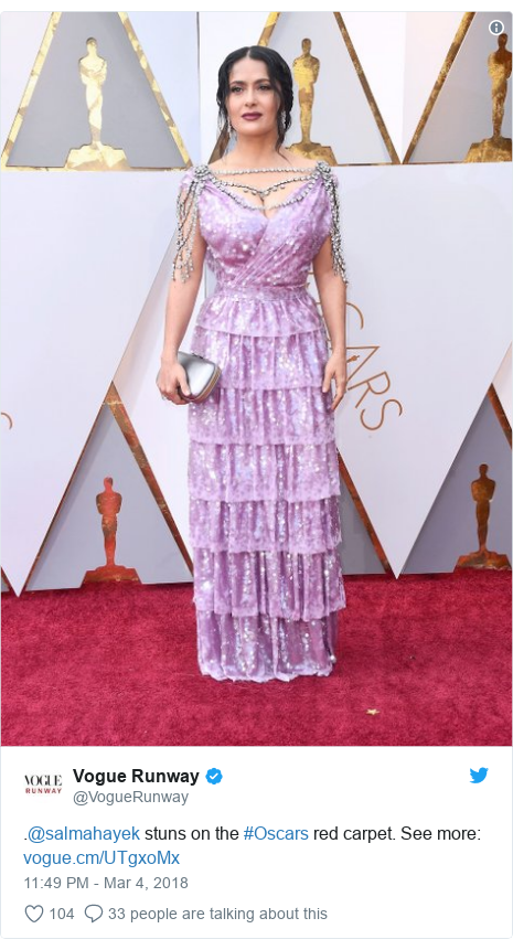 Twitter post by @VogueRunway: .@salmahayek stuns on the #Oscars red carpet. See more