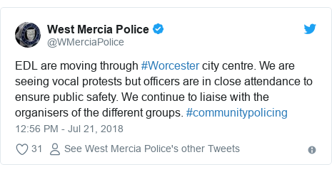 Twitter post by @WMerciaPolice: EDL are moving through #Worcester city centre. We are seeing vocal protests but officers are in close attendance to ensure public safety. We continue to liaise with the organisers of the different groups. #communitypolicing