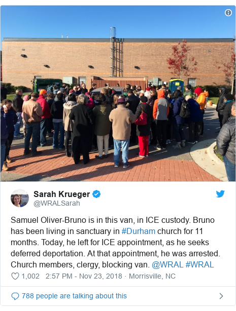 Twitter post by @WRALSarah: Samuel Oliver-Bruno is in this van, in ICE custody. Bruno has been living in sanctuary in #Durham church for 11 months. Today, he left for ICE appointment, as he seeks deferred deportation. At that appointment, he was arrested. Church members, clergy, blocking van. @WRAL #WRAL