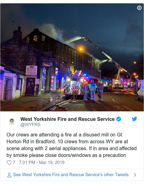 Twitter post by @WYFRS: Our crews are attending a fire at a disused mill on Gt Horton Rd in Bradford. 10 crews from across WY are at scene along with 2 aerial appliances. If in area and affected by smoke please close doors/windows as a precaution