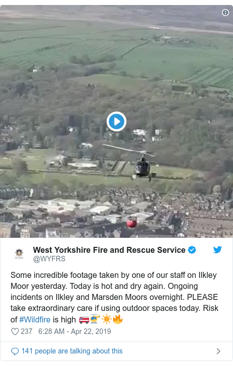 Twitter post by @WYFRS: Some incredible footage taken by one of our staff on Ilkley Moor yesterday. Today is hot and dry again. Ongoing incidents on Ilkley and Marsden Moors overnight. PLEASE take extraordinary care if using outdoor spaces today. Risk of #Wildfire is high 🚒🚁☀️🔥