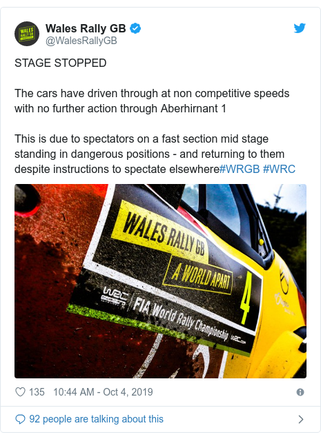 Twitter post by @WalesRallyGB: STAGE STOPPEDThe cars have driven through at non competitive speeds with no further action through Aberhirnant 1This is due to spectators on a fast section mid stage standing in dangerous positions - and returning to them despite instructions to spectate elsewhere#WRGB #WRC