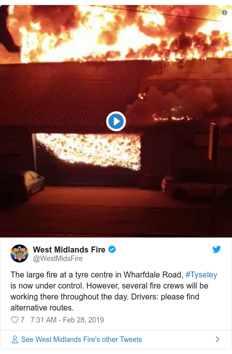 Twitter post by @WestMidsFire: The large fire at a tyre centre in Wharfdale Road, #Tyseley is now under control. However, several fire crews will be working there throughout the day. Drivers  please find alternative routes.