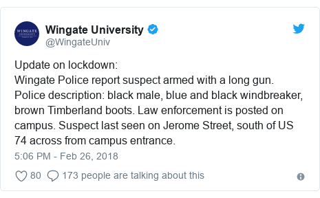 Twitter post by @WingateUniv: Update on lockdown Wingate Police report suspect armed with a long gun. Police description  black male, blue and black windbreaker, brown Timberland boots. Law enforcement is posted on campus. Suspect last seen on Jerome Street, south of US 74 across from campus entrance.
