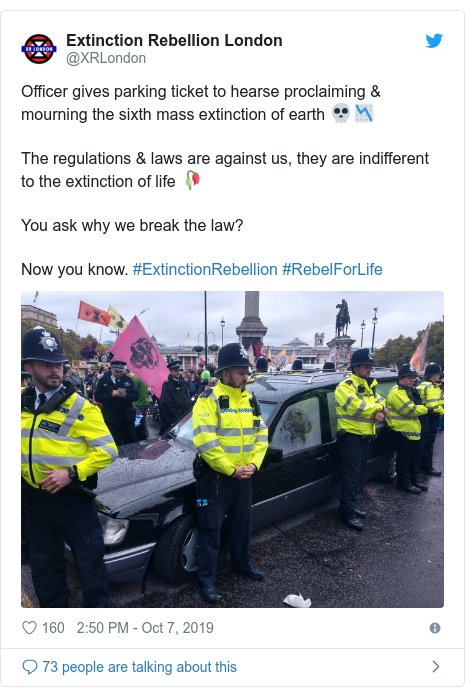 Twitter post by @XRLondon: Officer gives parking ticket to hearse proclaiming & mourning the sixth mass extinction of earth 💀📉The regulations & laws are against us, they are indifferent to the extinction of life 🥀You ask why we break the law? Now you know. #ExtinctionRebellion #RebelForLife
