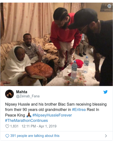Twitter post by @Zeinab_Fana: Nipsey Hussle and his brother Blac Sam receiving blessing from their 90 years old grandmother in #Eritrea Rest In Peace King 🙏🏿 #NipseyHussleForever #TheMarathonContinues