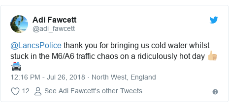 Twitter post by @adi_fawcett: @LancsPolice thank you for bringing us cold water whilst stuck in the M6/A6 traffic chaos on a ridiculously hot day 👍🏼🚔